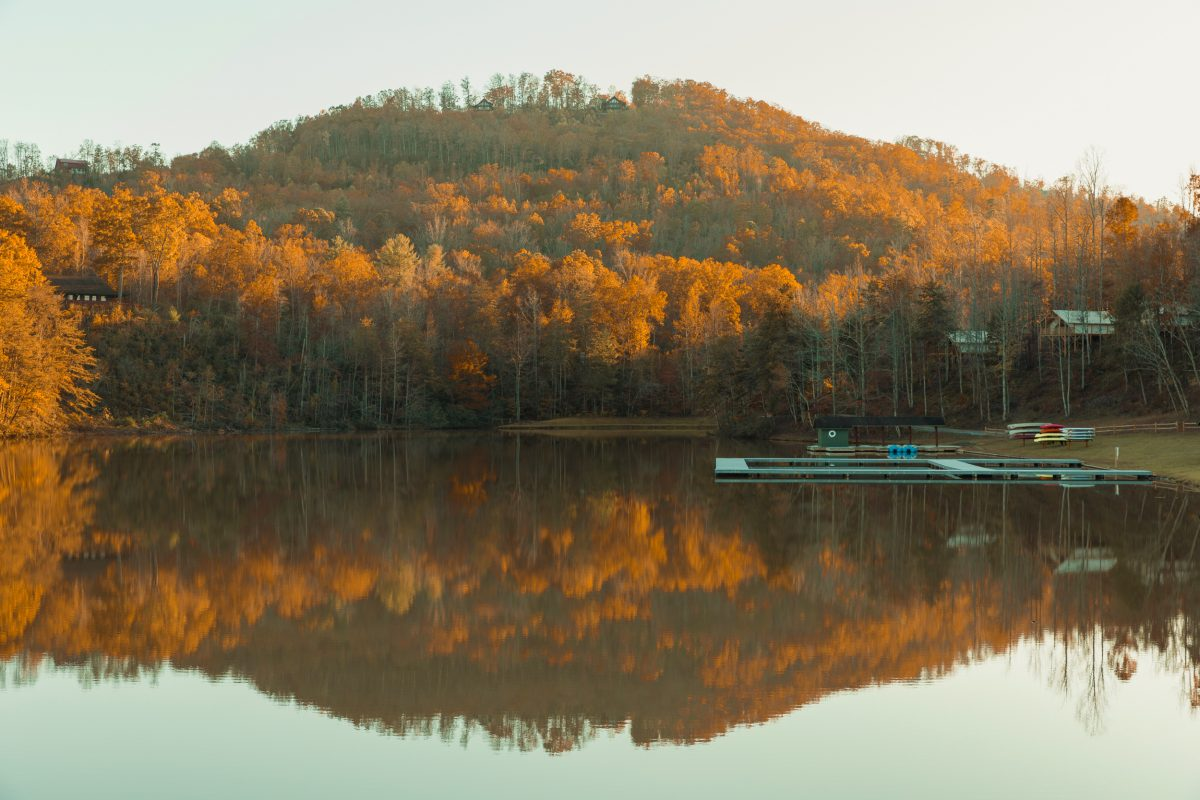 The golden trees reflecting off the water during the fall at Yogi Bear's Jellystone Park Camp-Resort: Golden Valley in Bostic, North Carolina.