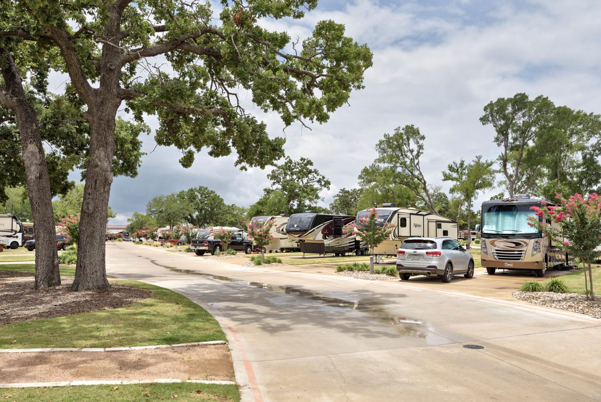 RVs parked at campsites at Oak Forest RV Resort in Austin, Texas.
