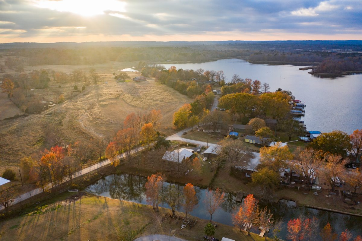 The sunset setting in the backdrop of an aerial view of Lake Palestine Resort in Frankston, Texas.