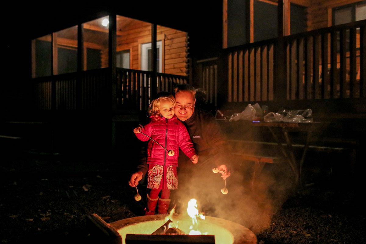 Roasting marshmallow around fire