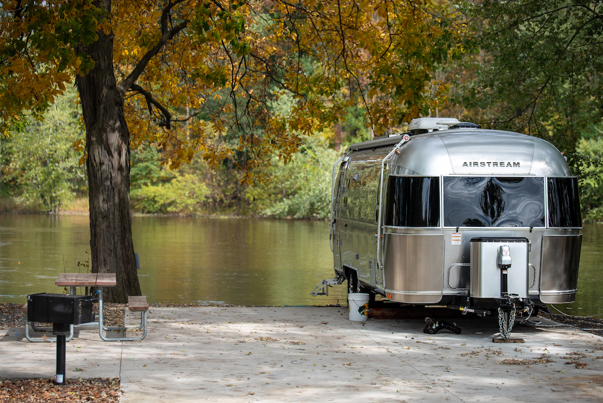 Airstream parked along river
