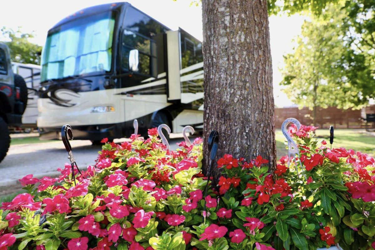 A motorhome parked at a campsite at Austin RV Park in Austin, Texas.