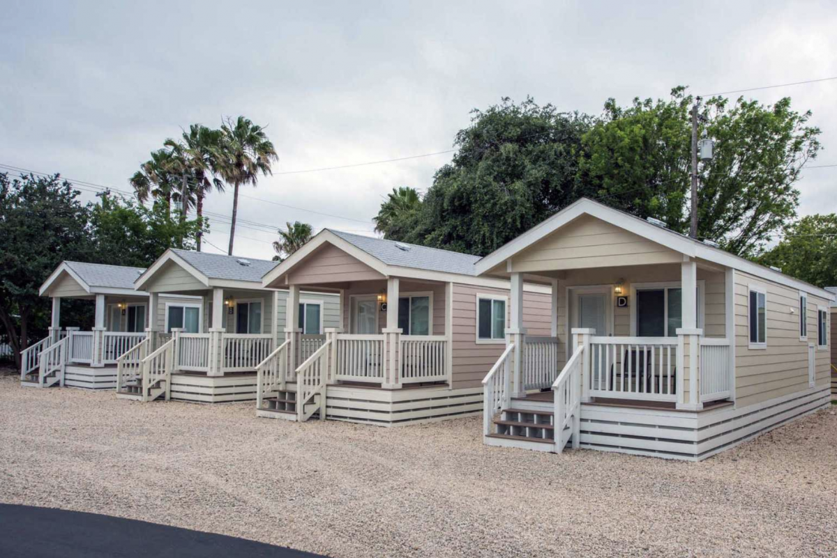The cottage and cabin rentals at Traveler's World RV Resort in San Antonio, Texas.