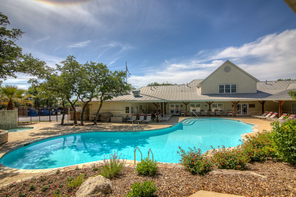 The pool and clubhouse at Blazing Star RV Resort in San Antonio, Texas.