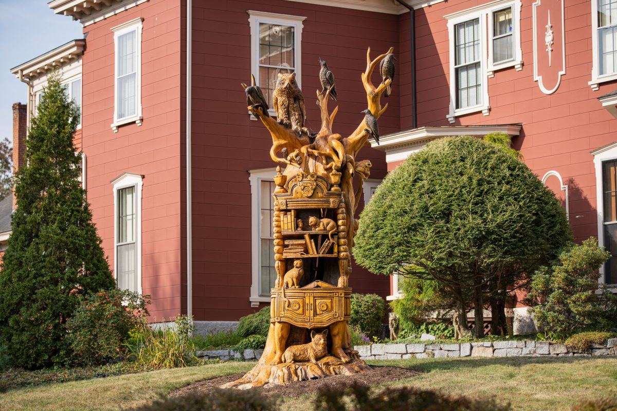 The statue carved from a dead ash tree in front of Stephen King's house in Bangor, Maine.