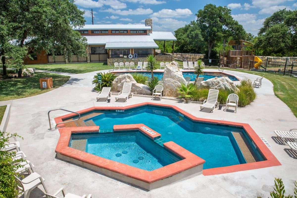 The pool and relaxation area at La Hacienda RV Resort in Austin, Texas.