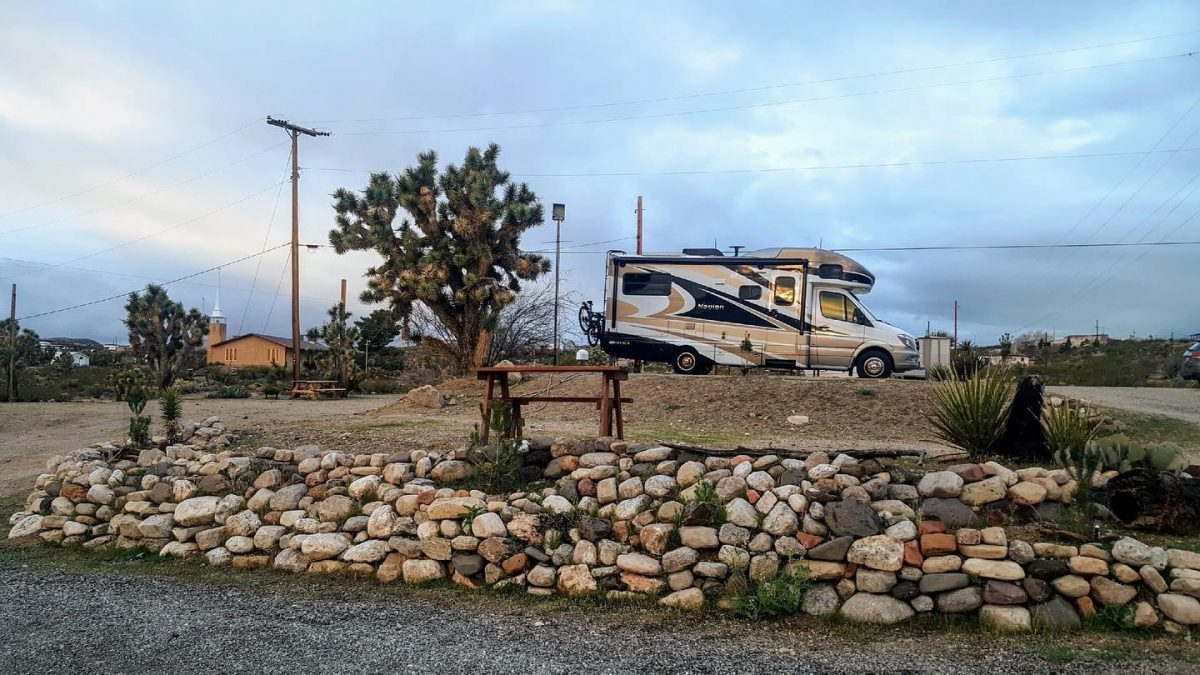 An RV parked at a site at Happy Trails Campground in Meadview, AZ.