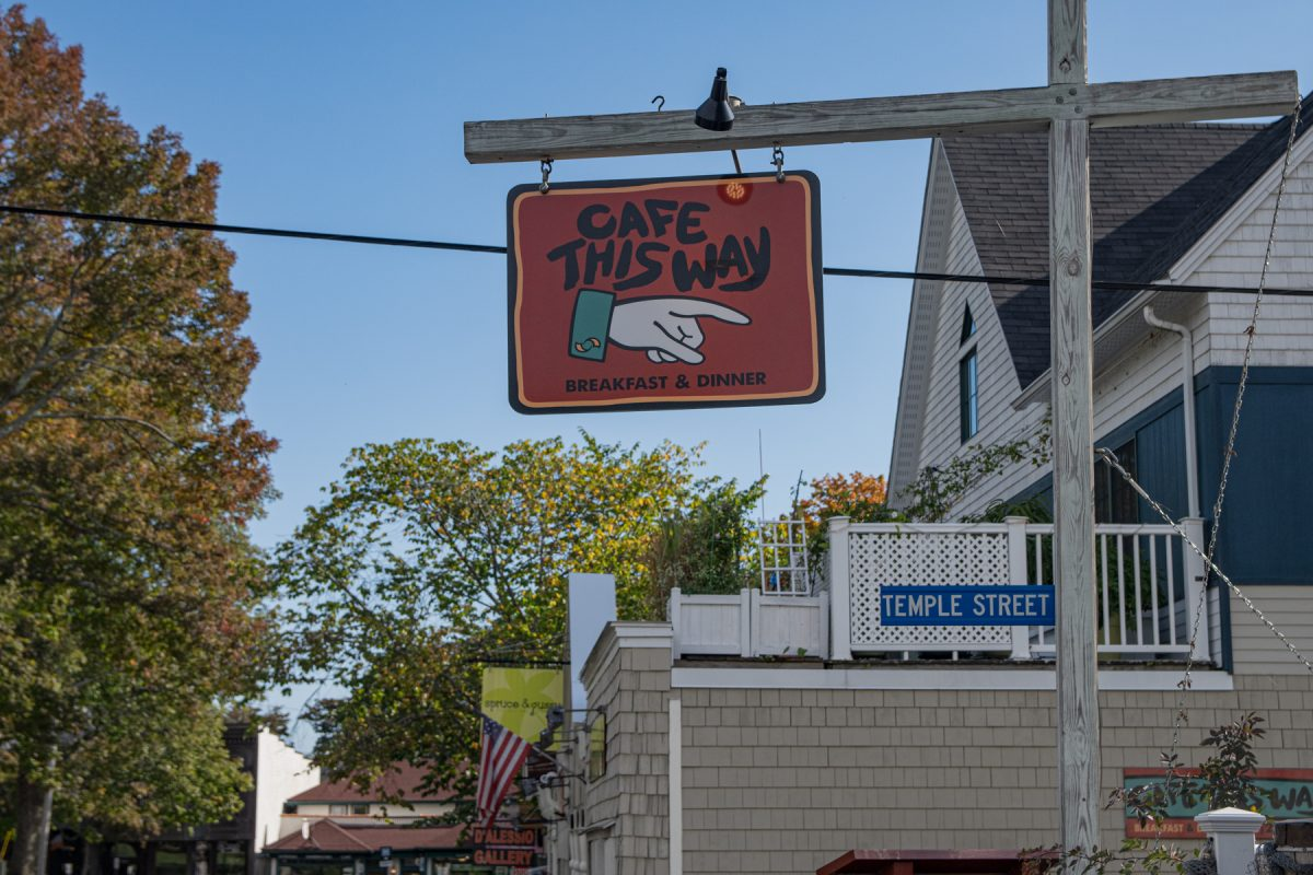 The street sign of Cafe This Way in downtown Bar Harbor, Maine.