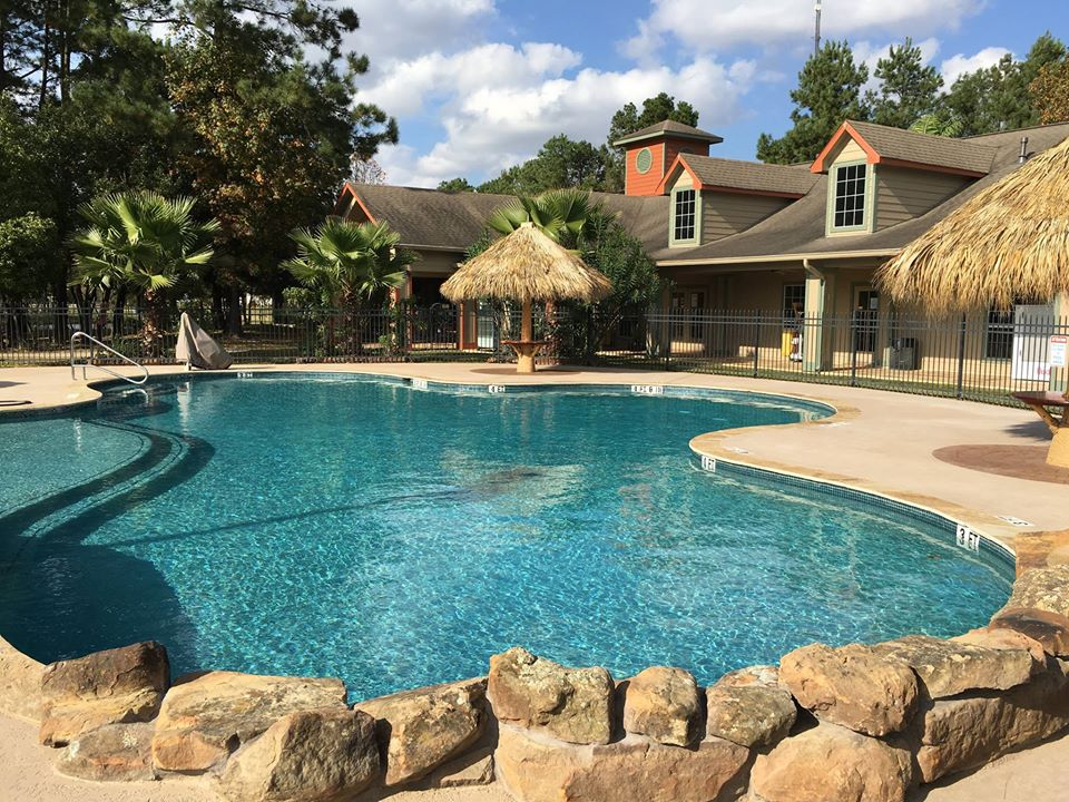 Rayford Crossing RV Resort in Spring, Texas, pool and relaxation area.