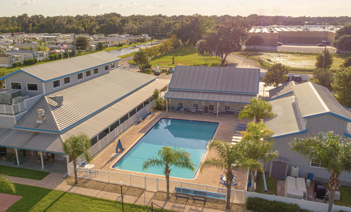 Aerial view of campground clubhouse and pool with RVs in background
